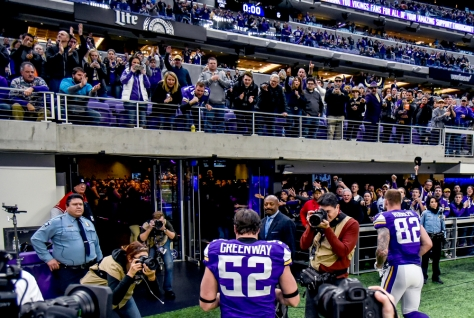 Minnesota Vikings' Chad Greenway (52) receives a roar of applause from the crowd as he walks back into the locker surrounded by the media following the Vikings win over the Chicago Bears in the final regular season game on Sunday at U.S. Bank Stadium in Minneapolis. Sunday's win over the Bears could be the 11-year-veteran's final game of his NFL career. Greenway said he will make a final decision about possible retirement before free agency.