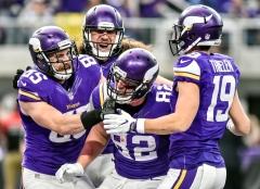 Minnesota Vikings' Kyle Rudolph (82) celebrates a touchdown with his teammates Minnesota Vikings' Rhett Ellison (85) and Minnesota Vikings' Adam Thielen (19) during the final regular season game on Sunday at U.S. Bank Stadium in Minneapolis.