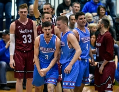Dakota Wesleyan's Trae Vandeberg (3) celebrates being fouled after grabbing a rebound off a missed free throw by Hastings College's Drew Callaghan (33) in the final seconds of a game on Saturday at the Corn Palace. DWU defeated the Hastings College Broncos 84-79.