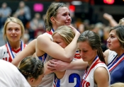 Sanborn Central/Woonsocket's Myah Selland (44) hugs her teammate Madi Moody after the Blackhawks fell to the Sully Buttes Chargers in the Class B state championship game on Saturday night at the Huron Arena.