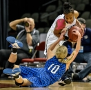 Dakota Wesleyan's Rylie Osthus (10) scrambles for a loose ball along with Eastern Oregon's Donniesha Webber (14) during a game in the second round of the NAIA Division II National Tournament on Friday at the Tyson Events Center in Sioux City, Iowa.