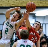 Colome's Kolton Salonen (2) and Gregory's Dylan Borszich (21) vie for a rebound during the district 12B championship game on Friday at the Corn Palace.