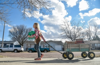 Brooke Emme (8) goes down Bridle Drive in Mitchell with her mom Debra selling girl scout cookies on Wednesday afternoon in Mitchell. Brooke has been a member of Troop 57005 for two years.