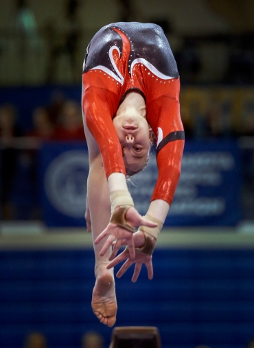 Deuel's Morgan Kwasniewski competes on the beam during the state gymnastics meet on Friday at the Golden Eagles Arena in Aberdeen.