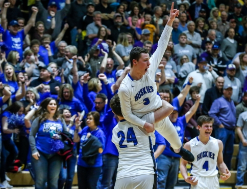 Bridgewater-Emery's Cade Schmitt (24) hoists Sawyer Schultz (3) on his shoulders as the Huskies defeated the Wolsey-Wessington Warbirds 63-58 for the Class B state championship on Saturday at the Wachs Arena in Aberdeen.