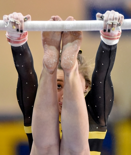 Mitchell's Maria Krall performs on the bars during the state gymnastics meet on Friday at the Golden Eagles Arena in Aberdeen.