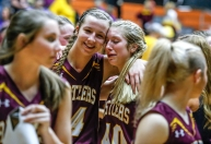 Ethan's Janae Gustafson, left, hugs teammate Ellie Hohn while walking off the court after defeating the Warner Monarchs for third place during the Class B state tournament on Saturday night at the Huron Arena.