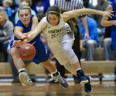 Dakota Wesleyan's Sarah Carr (40) and Concordia's Colby Duvel (50) scramble for a loose ball during a Great Plains Athletic Conference game on Sunday at the Corn Palace.