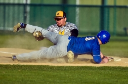 Mitchell first baseman Bryce Geraets records the tag on Sioux Falls O'Gorman's Grady Gulbranson on a throw back play to first to record the final out of a game on Thursday night at Cadwell Park.