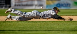Mitchell's Elijah Pommer dives for a Sioux Falls O'Gorman hit during a game on Thursday night at Cadwell Park.