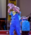 Cousin Grumpy reacts to the young piglet peeing on him while the crowd sings the 'Old Macdonald' during his pork chop review as part of the El Riad Shrine Circus on Monday night at the Corn Palace.