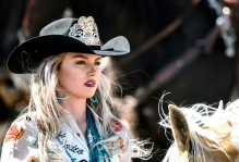 Junior Miss Rodeo South Dakota Adrianne Schaunaman, of Aberdeen, watches the action during the Wessington Springs Foothills Rodeo at the Jerauld County 4-H Grounds.