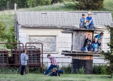 Kids play around the storage shed and a top of wooden spools during the Wessington Springs Foothills Rodeo at the Jerauld County 4-H Grounds.