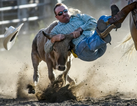 Bryce Baker, of Ft. Pierre, competes in the steer wrestling competition during the Wessington Springs Foothills Rodeo on Saturday at the Jerauld County 4-H Grounds.