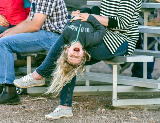 Avery Olson has a laugh bouncing upside down while attending the Wessington Springs Foothills Rodeo on Saturday at the Jerauld County 4-H Grounds.