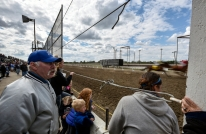 Spectators watch as the horse reach the finish line of the eighth and final race of the Pari-Mutual Horse Races at the Brown County Fairgrounds on Monday in Aberdeen.