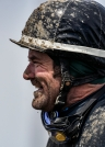 Jockey Damon Leeds smiles while covered in dirt and mud walking back to the lockers after riding Steven Keplin Jr.'s General Election in the 5th race during the Pari-Mutual Horse Races at the Brown County Fairgrounds on Sunday in Aberdeen.