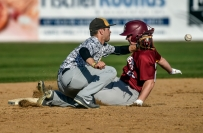 Mitchell's Drew Kitchens is unable to get the throw to second in time as Sioux Falls Roosevelt's Justin Aldrich slides safely during the first game of a doubleheader on Thursday at Cadwell Park. (Matt Gade / Republic)