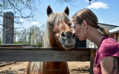 Crystal Young goes nose-to-nose with her horse Bumblebee at Reclamation Ranch. Reclamation Ranch is a place for therapeutic riding for people.