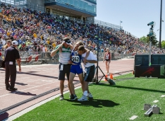 Mitchell Christian's Adaya Plastow is helped off the track after finishing the 800 meter run during the first day of the Class B state track meet at Howard Wood on Friday in Sioux Falls.