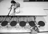 Girl Scout Troop 57705's Kate Ahlers, 11, right, and Grace Hempel, 10, clean a cafeteria table at John Paul II Elementary School on Wednesday afternoon as part of the United Way's Day of Caring kick-off campaign.