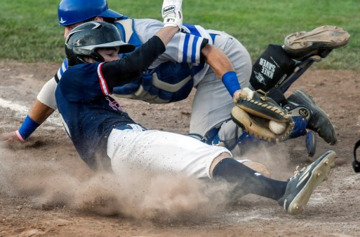 Winner/Colome's Hartman Katz (21) gets the tag on Legion pick-up player for Vermillion Cole Anderson (10) at home during a second round game in the South Dakota State Amateur Baseball Tournament on Sunday at Cadwell Park.
