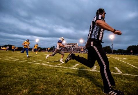 Dakota Wesleyan's Luke Loudenburg (23) races past the Dakota State defense for a touchdown during a game on Thursday night in Madison.