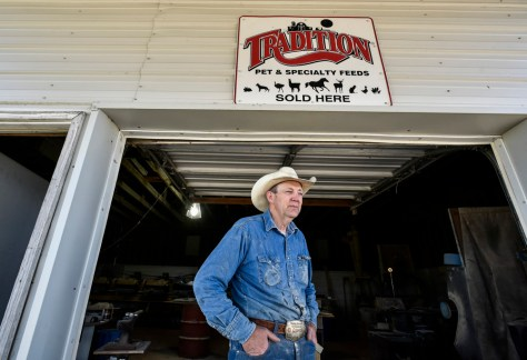Lonnie Smith, owner of Drifting Cowboy Saddle Shop, stands in the doorway to the workshop, a rented out former feed shop, right across the street from his main shop in Ree Heights. In the slowly shrinking town of Ree Heights, pop. 60, Smith didn't want to move out of town when he realized he needed more space for his shop and approached the owners of the former feed shop who Smith said were happy to rent it out to someone in town.