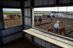 Riders and competitors warm up their horses in the secondary arena before the start of the Winner Elks Benefit Rodeo on Sunday night at the Tripp County Fair and Rodeo Grounds in Winner.
