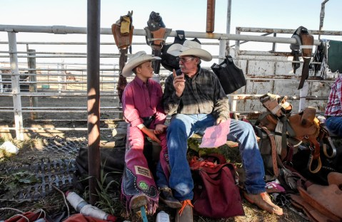 Taos Weborg, left, gets some words of wisdom from Jerry Hutchison, of Burke, before competing in the mini-saddle bronc during the 28th Annual Burke Stampede Rodeo on Saturday night at the Burke, South Dakota Rodeo Arena in Burke. Future Broncs and Bares events were added to the Burke Stampede Rodeo for the first time this year. Weborg won the HPYR Saddle Bronc & HPYR All-Around Champion.