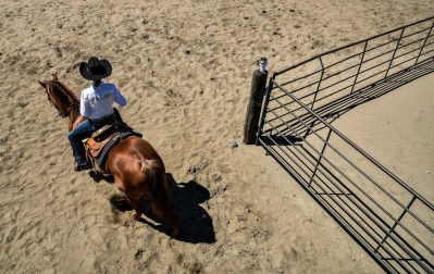 Bailey Feistner, of Woonsocket, rides her horse up to the arena to compete in the Sanborn County horse show on Monday afternoon at the Sanborn County 4-H grounds in Forestburg.