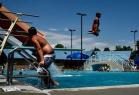 Kids take turns off the diving board at the Mitchell Aquatic Center on Thursday afternoon. The Aquatic Center will have regular hours of 1 p.m.- 8 p.m. through the weekend and on Monday, but will close at 5 p.m. on Tuesday for the holiday.