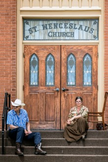 Leander Vyhlidal, of Norfolk, Neb., and Adrianne Adderley, of Yankton, sit on the stoop in front of St. Wenceslaus Church watching the parade go by during the 69th Annual Czech Days parade on Friday, June 16, 2016 in Tabor.