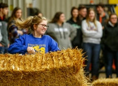 Wessington Springs sophomore Emma Lammey carries a hay bale while competing in the Ag Olympics in the Wessington Springs Ag building back in February as part of National FFA Week. (Matt Gade / Republic)