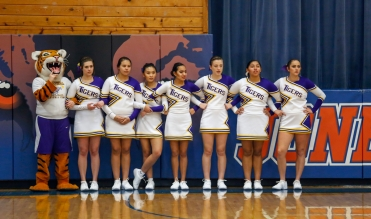 The White River cheerleaders stand for the presentation of colors before the start of a game between White River and Bennett County marking the start of the first game of the 50th Jones County Invitational Tournament on Thursday in the Harold Thune Auditorium in Murdo.