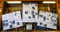 Old newspaper clippings are hung up on the trophy case inside the Harold Thune Auditorium for the 50th Jones County Invitational Tournament on Thursday in Murdo.